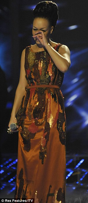 Gracious: She was clad in a gold dress before wearing an intricate orange gown later in the show and became emotional as mentor Cheryl and the rest of the judges told her how proud they were of her