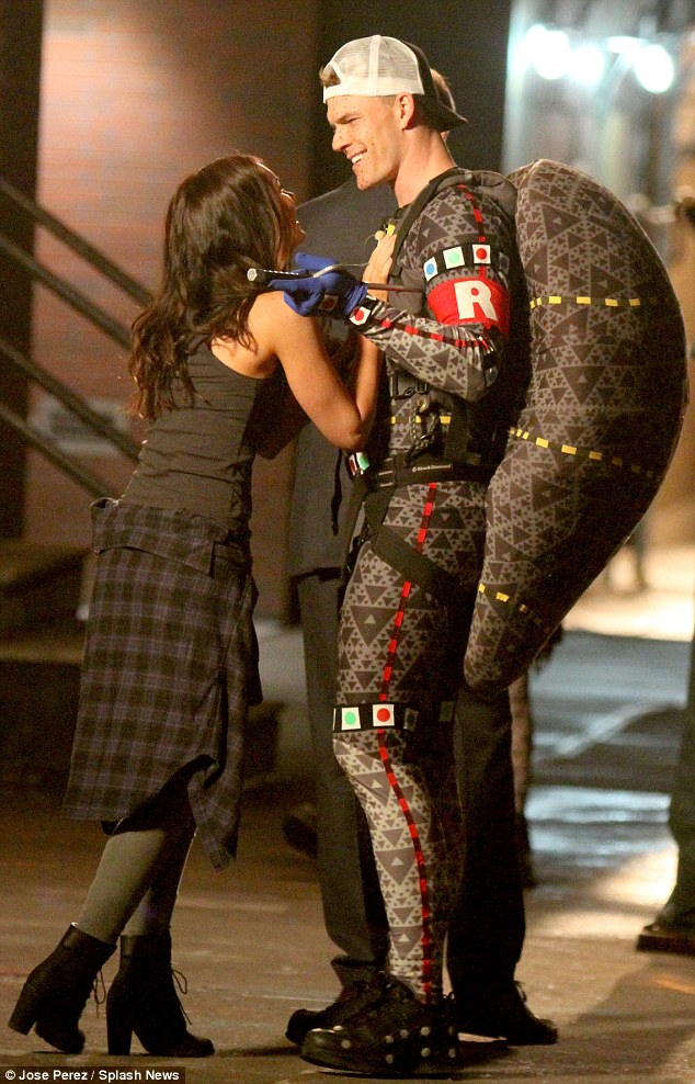 April O'Neil: Megan was dressed in a dark tank top, grey jeans and boots with a plaid shirt wrapped around her waist as the reporter and friend of the four reptilian superheroes