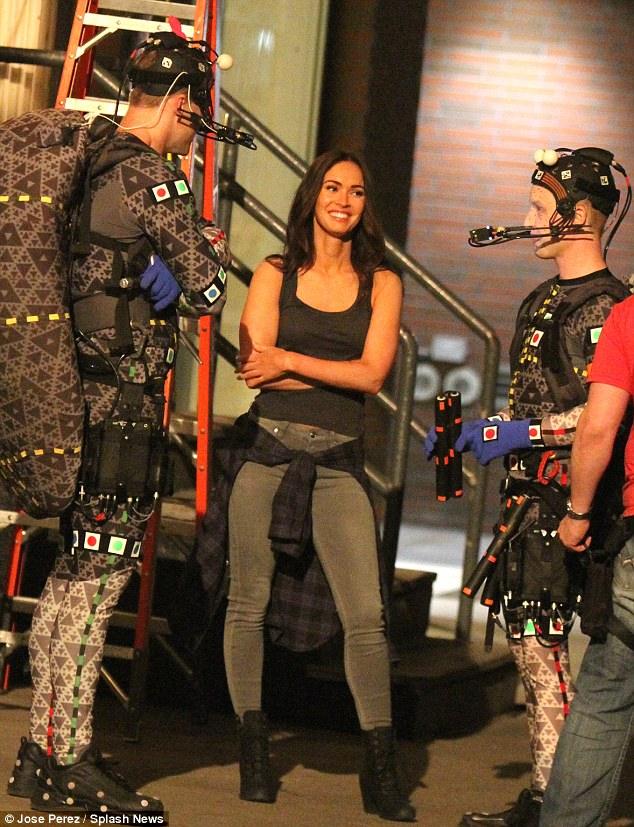 Fun on set: Megan Fox was seen enjoying a moment between scenes with co-stars Alan Ritchson and Noel Fisher