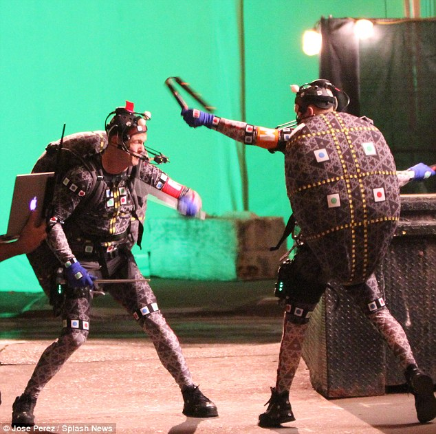Working it through: The men showed off their fight moves in their motion capture suits