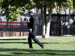 A U.S. Secret Service officer walks the grounds near the North Portico during a lock-down at the White House, Saturday, Nov. 5, 2016 in Washington. According to the Secret Service, a Secret Service Uniformed Division Officer noticed a man with a weapon in a holster while walking on Pennsylvania Avenue near Madison Place. The officer confronted the man and a brief struggle ensued,  before the man was arrested.  President Obama was not at the White House during the incident. (AP Photo/Alex Brandon)