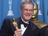 "FILE - In this March 25, 2001, file photo, Rob Cook poses backstage with Loren Carpenter, not seen, with his Oscar for significant advancements to the field of motion picture rendering as exemplified in Pixar's ""Renderman,"" at the 73rd annual Academy Awards in Los Angeles. Cook is taking over a U.S. government agency responsible for improving federal digital technology. After more than four decades in the private sector, Cook will become commissioner of the Technology Transformation Service on Oct. 31. He will have top secret security clearance. (AP Photo/Richard Drew, File)"