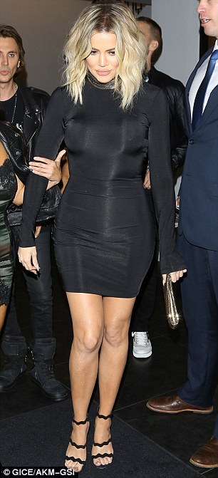 Woman in black: Khloe flaunted her enviable curves in a tight-fitting black dress with a shimmering high neck