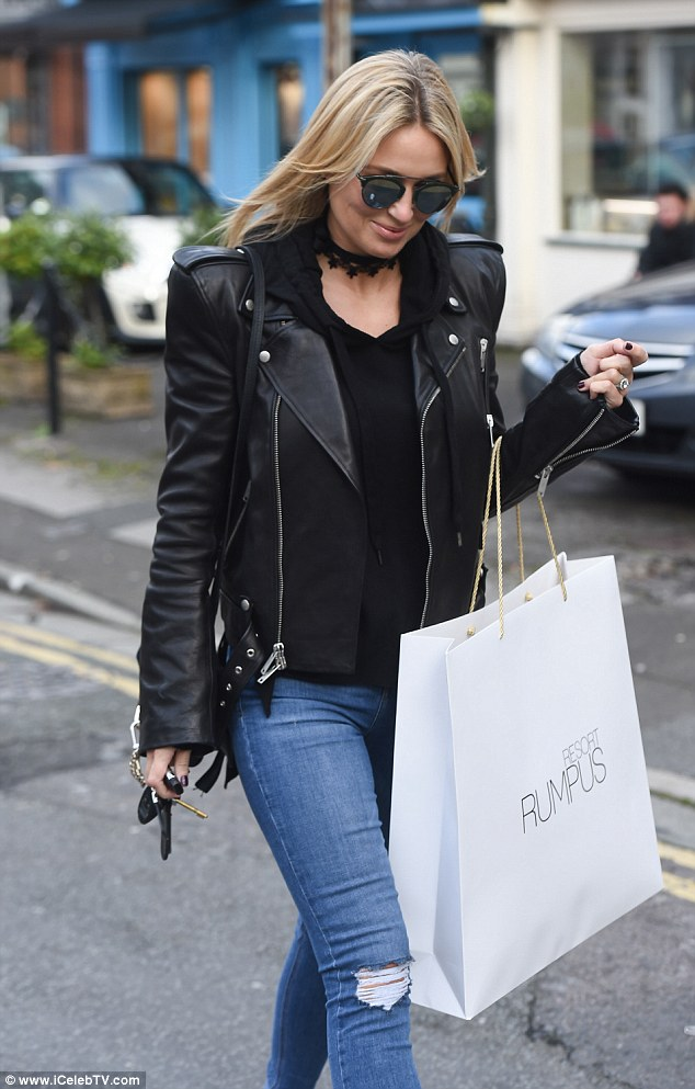 Turning heads: Covering her potential bump, she wore a pretty black blouse with a matching choker