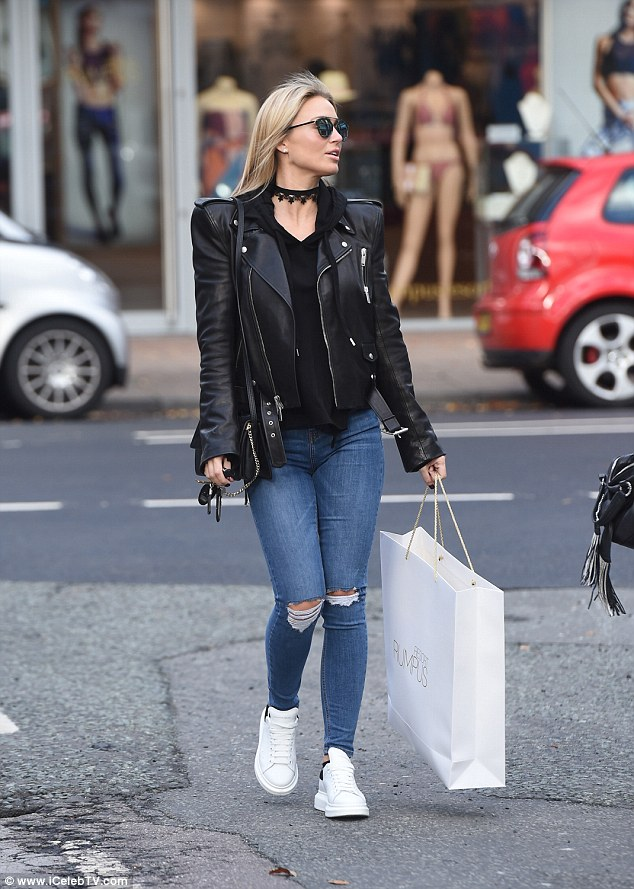 Chic: The 34-year-old mother-of-three cut a stylish figure in a black leather jacket and frayed jeans as she headed out for a spot of shopping