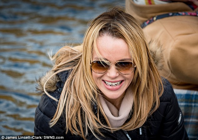 Golden gal: Leaving her golden locks loose, Amanda hid her facial features with a pair of simple gold aviators as she was spotted an occasion appropriate birthday cake