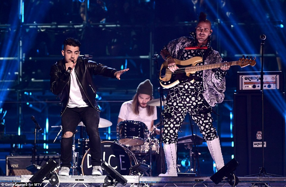 Flying high: Joe Jonas and DNCE attempted a show-stealing cameo by playing from a descending lighting rig