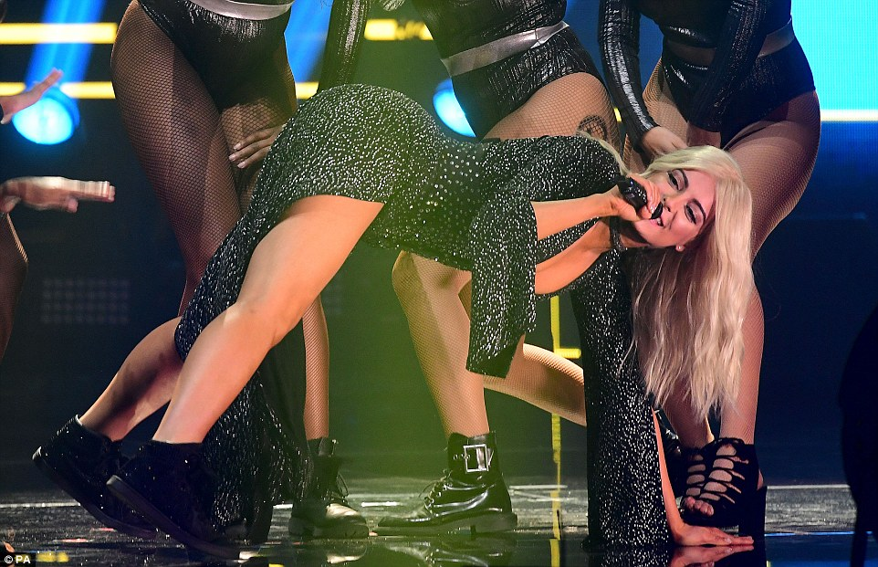 Flexible dresser: The black, sparkling fitted number, featured an extremely plunging neckline as well as an asymmetrical thigh-high split that allowed the singer to flash her cleavage and gym-honed pins.