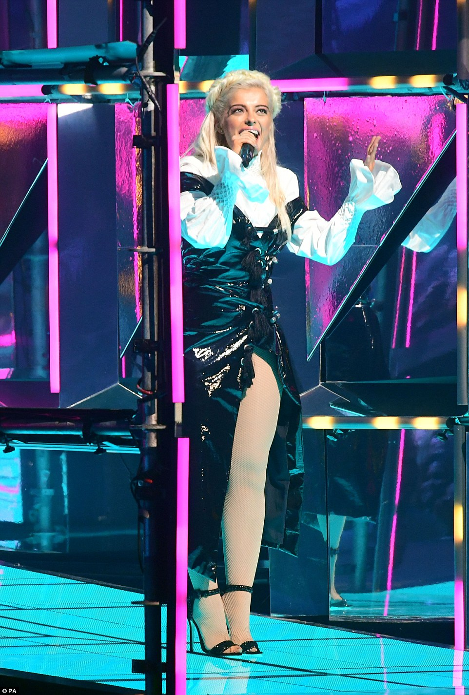 That makes seven: A seventh outfit changed saw her team an Elizabethan style shirt with a PVC thigh-high gown