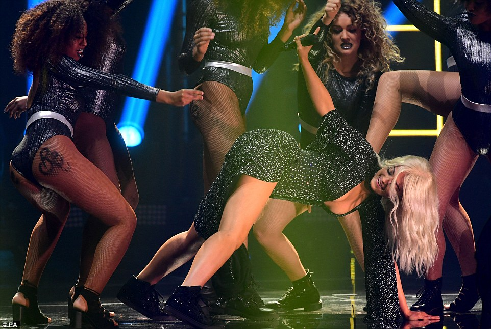Twerk it: Rounding the look off with a a pair of black sneakers, the singer had no problems launching into a raunchy twerking dance routine with her a troupe of scantily-clad dancers