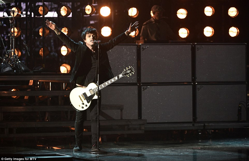 Showing their colours: Punk rocker icons Green Day made a political statement by re-jigging their naughties anthem, American Idiot