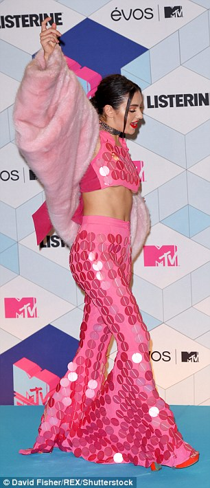 Revealing: The pop songstress revealed a hint of underboob as she larked around
