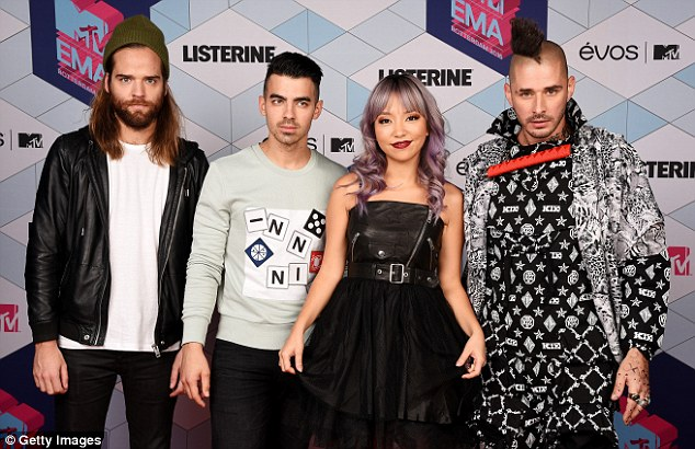 His band: Joe with Jack Lawless, JinJoo Lee and Cole Whittle of DNCE