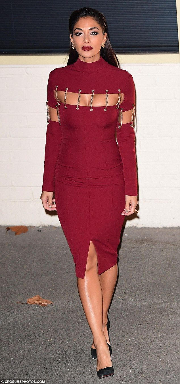 Sizzling! Nicole Scherzinger continued to set pulses racing as she left the X Factor studios following Saturday's live show