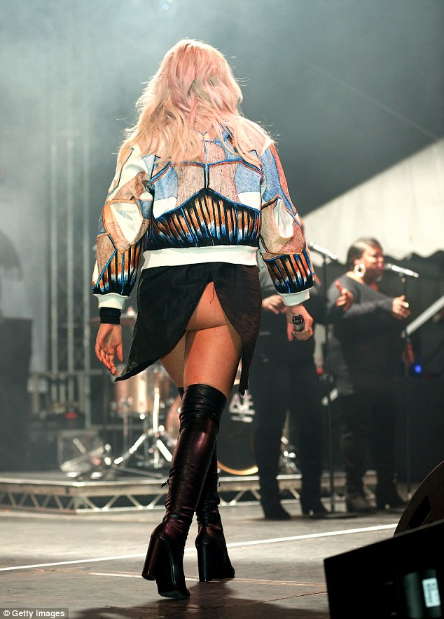 Oops moment: Louisa Johnson suffered an unfortunate wardrobe malfunction at Sheffield's Christmas lights switch-on on Thursday night when her skirt got tucked into her waistband