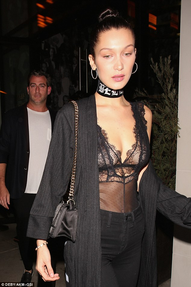 Bra-vo! The model of the moment stole the spotlight in a sheer lace bralet bodysuit which flaunted her perky cleavage and flat abs