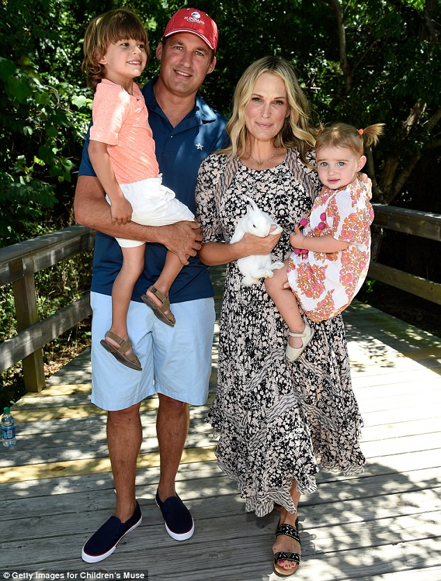 Happy family: The blonde beauty is mum to son Brooks Alan, four, daughter Scarlett May, one, and her unborn child. She is pictured in July in the Hamptons