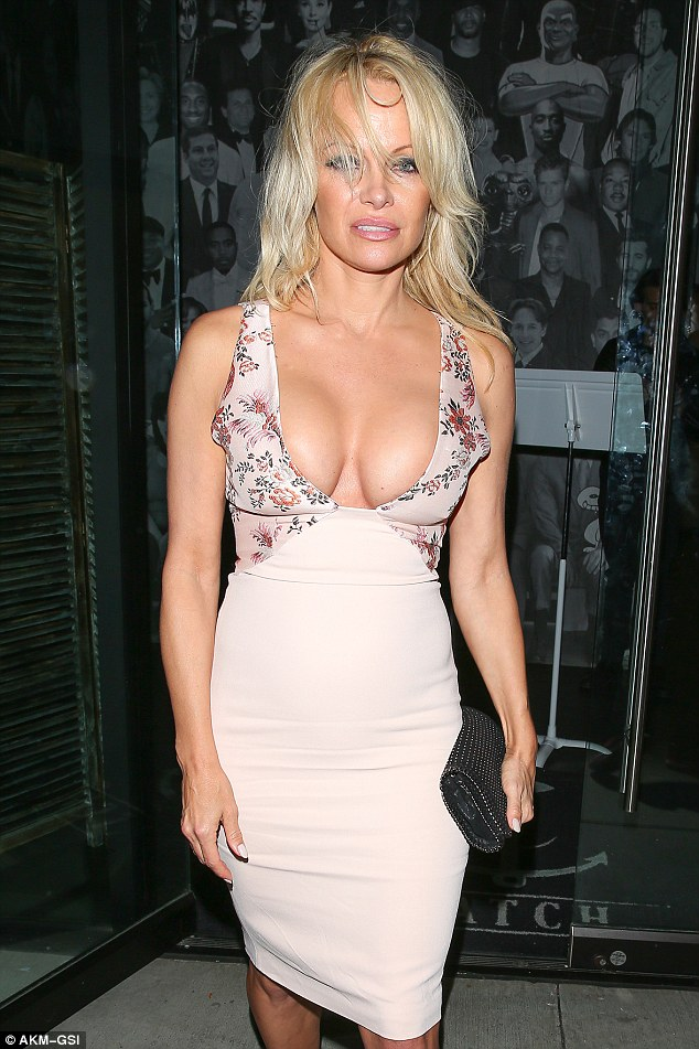 Dared to bare:Pamela showed off the curves she was famous for in a low cut gown at the West Hollywood eatery