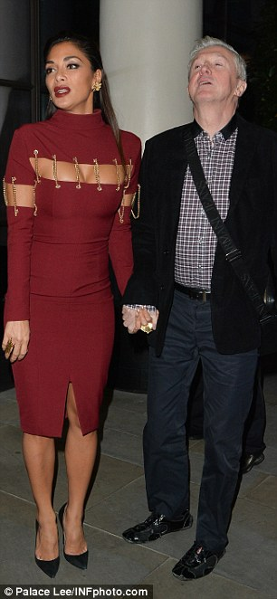 Louis Walsh and Nicole Scherzinger held hands outside the Beaumont hotel in London