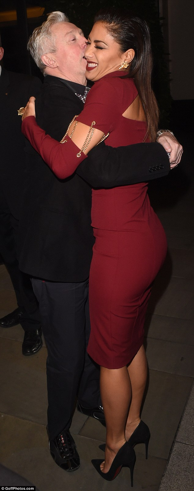 Louis Walsh certainly looked like he was having a merry old time as he hugged Nicole Scherzinger outside a London hotel