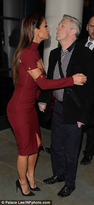Shock and awe: Louis Walsh and Nicole puckered up for each other outside the exclusive Mayfair hotel