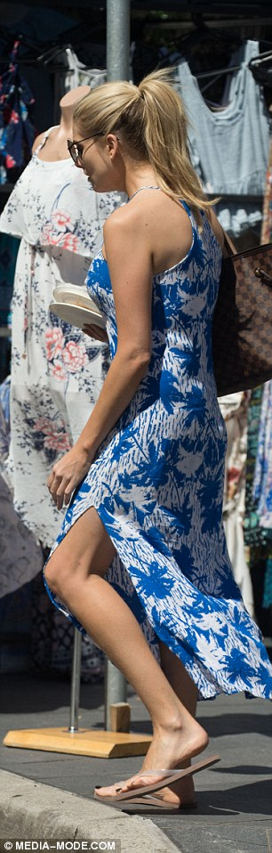 Putting her best foot forward! A thigh high split in the 34-year-old's dress showed off her trim pins