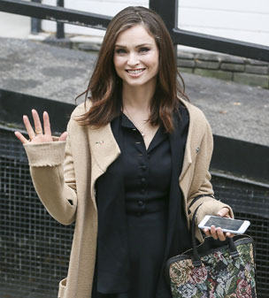 Keeping it casual: Sophie Ellis-Bextor teamed a cosy knit with a simple black dress for her visit to the ITV Studios.