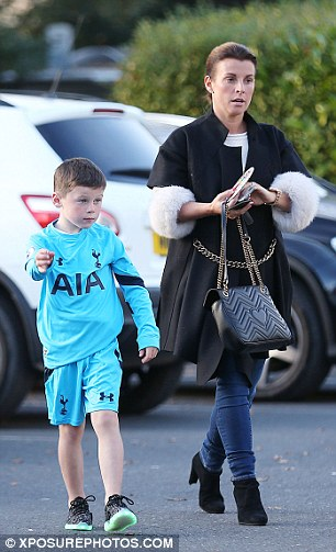 Birthday blues? Kai donned the kit as he enjoyed a day out with his 30-year-old mum Coleen after he celebrated turning seven