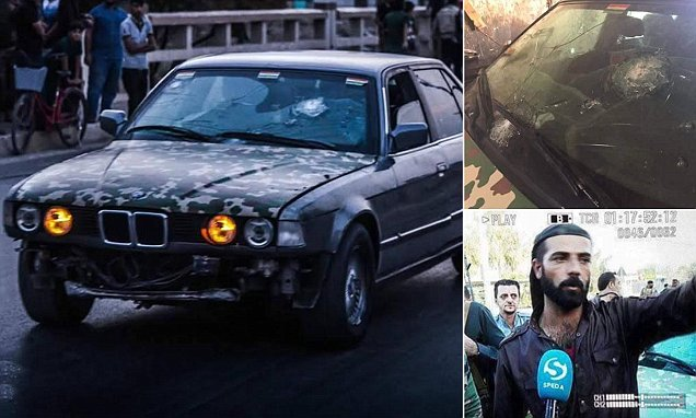 Peshmerga soldier uses armour-plated BMW to rescue dozens of civilians pinned down by