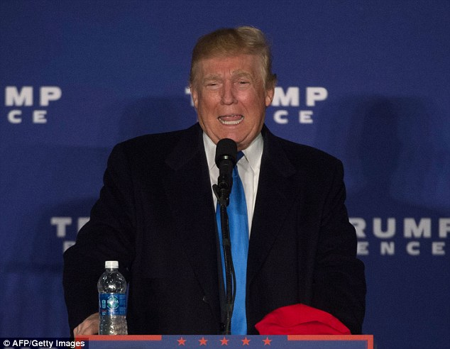 Trump (pictured in Leesburg, Virginia in the early hours of Monday morning) will be in Grand Rapids, Michigan from 11 p.m. Monday evening