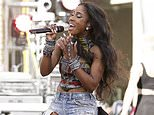 """FILE - This April 1, 2015 photo, Sevyn Streeter performs on stage at the """"Furious 7"""" Takeover held at the Revolt Live Studios in Los Angeles.  Streeter and the Philadelphia 76ers have decided on a date for the singer to come back and perform the national anthem after the team didn?t allow her to sing wearing a ?We Matter? jersey. In statements to the Associated Press on Saturday, Nov. 5, 2016, the 76ers and Streeter said she would perform wearing her ?We Matter? jersey at the team?s Dec. 16 home game against the Los Angeles Lakers.(Photo by John Salangsang/Invision/AP)"""