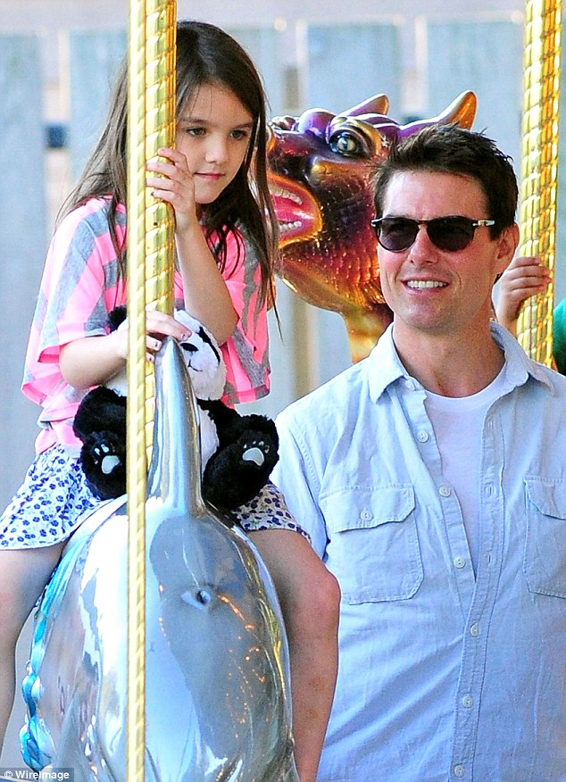 Close again: Tom Cruise spent five days with daughter Suri in England in July, UsWeekly has claimed. Here they are seen in 2011