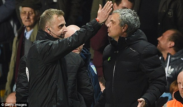 Final conflict: Mourinho turns his attention to fourth official Jon Moss, who shows him the way off