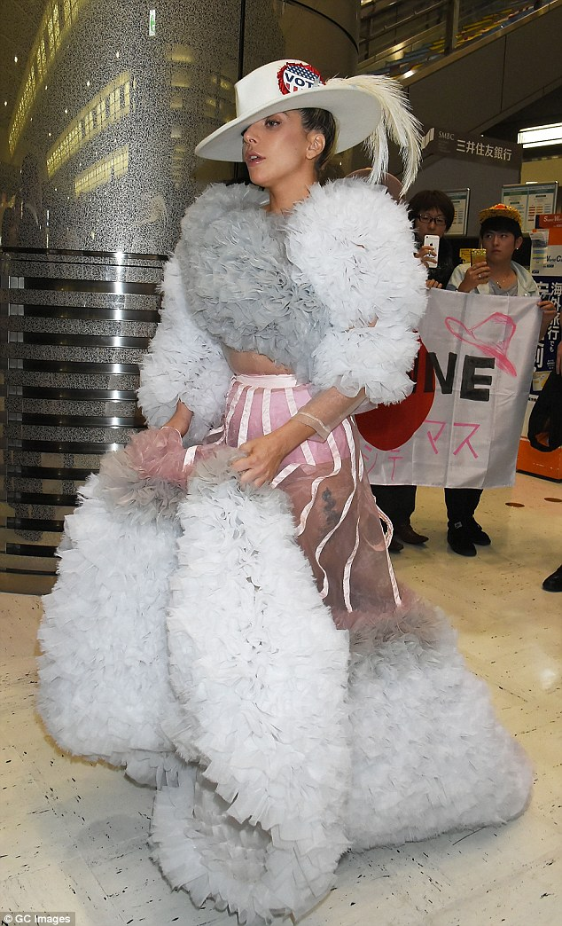 Lady Gaga, who is in Japan promoting her new album Joanne, pinned a corset to the back of her fantastical outfit