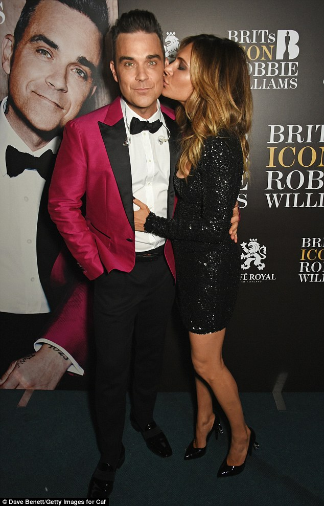 Pucker up! Robbie Williams, 42, and Ayda Field, 37, still looked to be in the first flushes of love as they cosied up London's The Troxy on Monday night