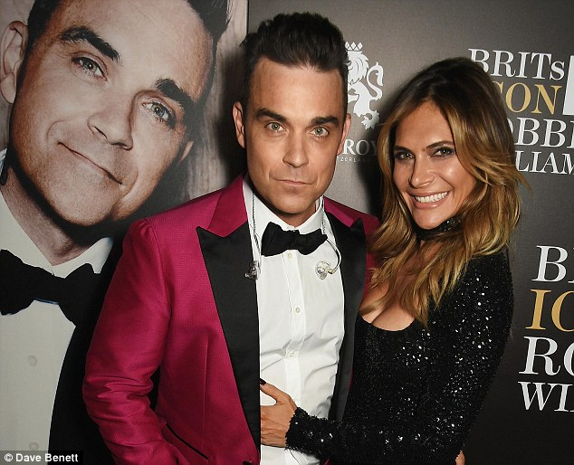 Suave: Robbie looked suitably dapper to collect the accolade in a sharp red blazer and a jaunty bow tie