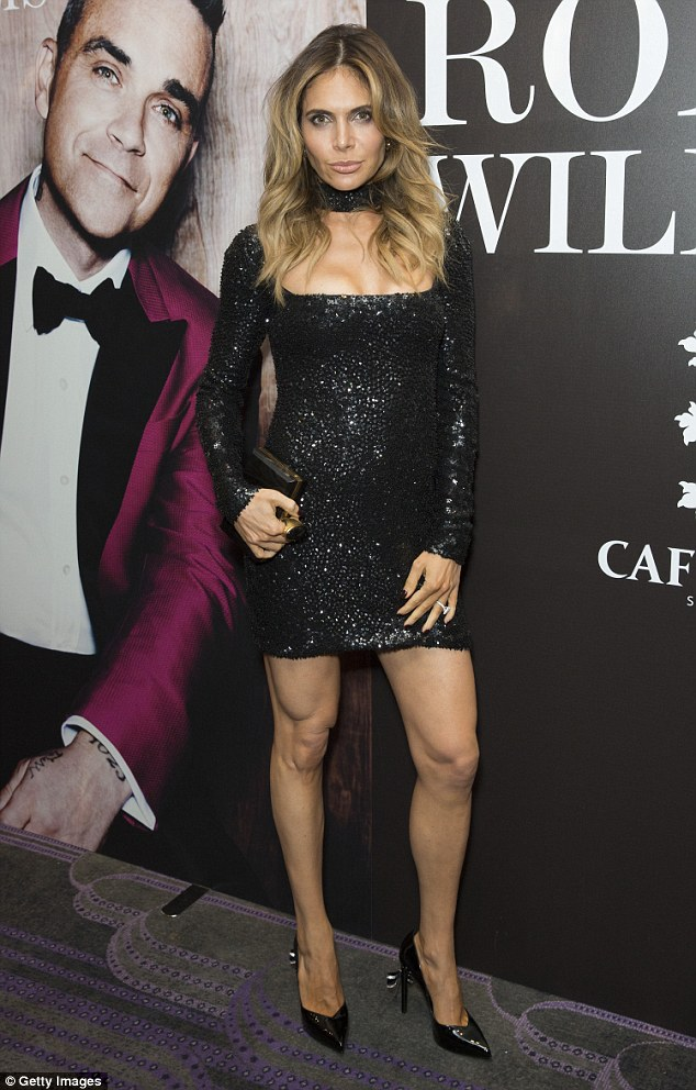 Striking: Letting her statement dress do the talking, Ayda added height with some vertiginous black pumps
