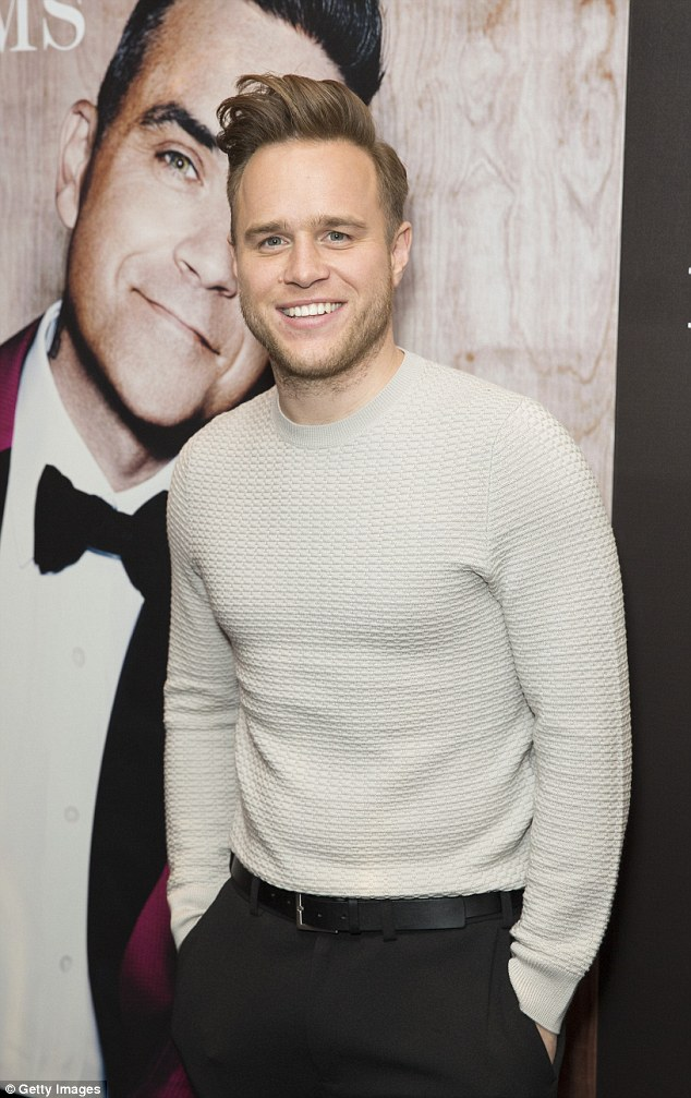 Fellow entertainer: Olly Murs looked casual in a cream jumper as he turned out to support Robbie
