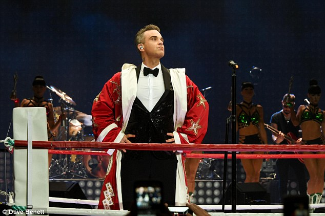 Blast from the past: On Sunday night Robbie Williams gave a special one-off show at The Troxy to celebrate receiving the prestigious BRITs Icon Award- and was joined by Take That