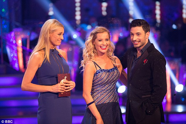 Out: Laura and dance partner Giovanni were voted off Strictly Come Dancing on Sunday night. They are seen with co-host Tess Daly
