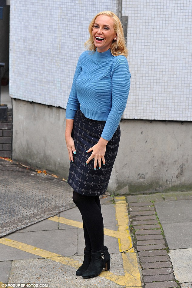 Not feeling blue: She was dressed for winter in a skirt and jumper combination