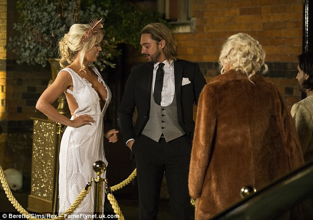 Strictly suave:Injecting his own style into the black-tie affair, the long-haired hunk worked a grey waistcoat with a crisp white shirt and black tie as he placed a white pocket square into his blazer