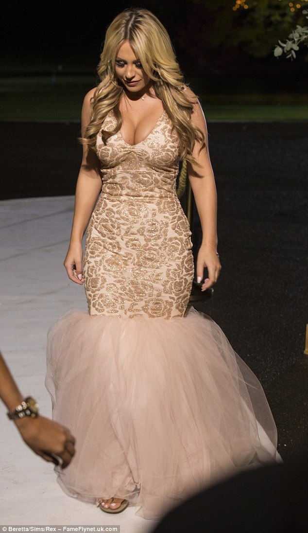 Fit to bust!Cutting into an extremely low V neck, the dress was then made sexier as it pushed up her famously rounded chest, leaving ample amounts of cleavage on show