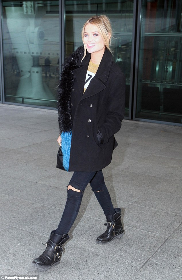Still smiling: Laura Whitmore proved Strictly Come Dancing disappointment won't dim her light as she left London's Heathrow Airport with a huge smile on her face on Monday