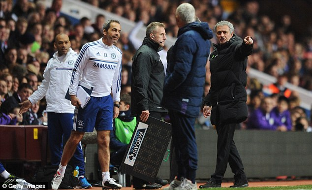 Not happy: Mourinho protests to the fourth official after the handball decision in the first half