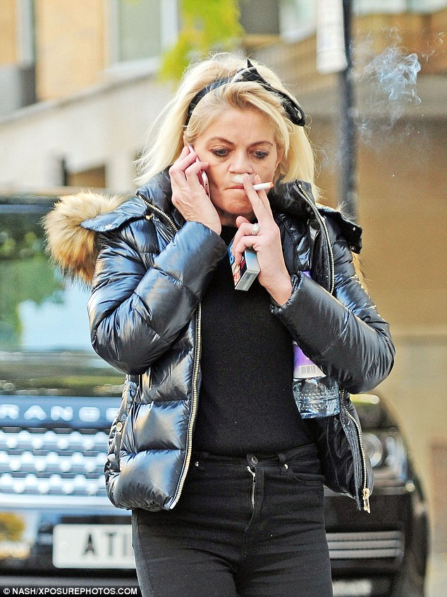 Up in smoke: The CBB contestant was seen chainsmoking as she walked through London
