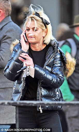 Carrying on: The actress, 43, seemed keen to carry on with normal life and chatted on the phone