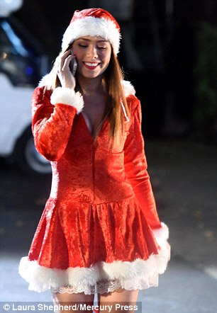 Upbeat: Having embraced the festive theme Nikki appeared to be in high spirits as she chatted  on her mobile phone