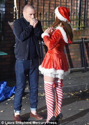 Ready to roll: The pair were filming alone on a set adorned with decorations as the Channel 4 show prepared to shoot scenes for a forthcoming Christmas episode