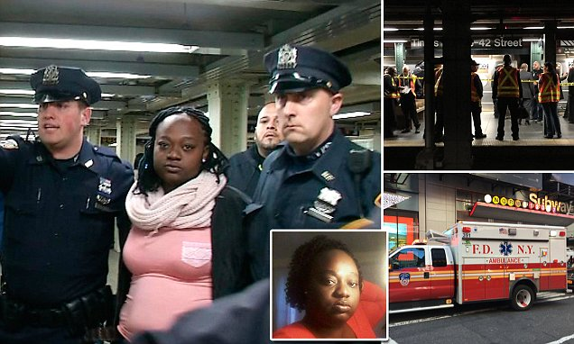 Woman taken into custody after 'shoving' another woman in front of train at Times Square